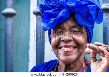 Portrait of african cuban woman smoking cigar in Havana, Cuba