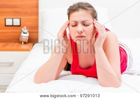 Young Brunette Woman Suffering From Migraine
