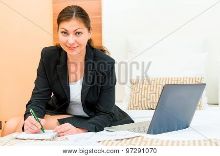Beautiful Successful Woman Working At The Hotel Beds