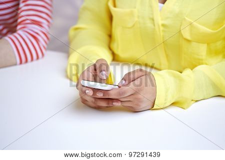 people, technology and internet concept - close up of african american teenage girl hands with smartphone