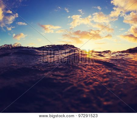 Ocean Waves at Sunset.  Abstract View of Water and Sky at Sunset.