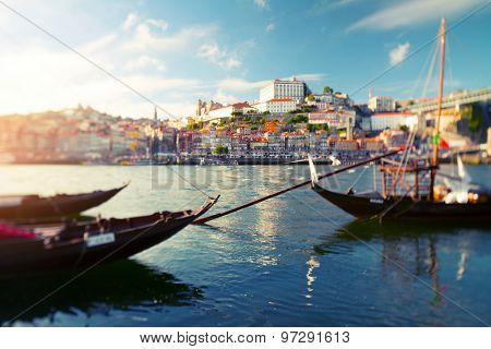 Traditional portuguese boats on the river of Douro with the city of Porto on the background. Tilt shift lens used with focus on the middle of shot