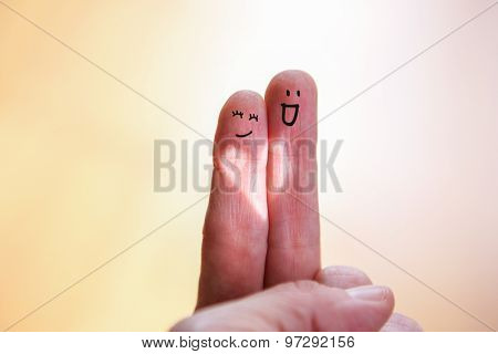 Happy finger couple with heart shaped light, focus on heart