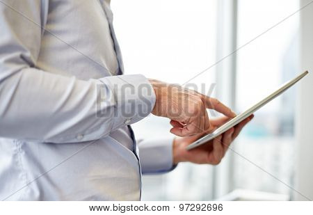 business, technology, internet and people concept - businessman looking to tablet pc computer at office
