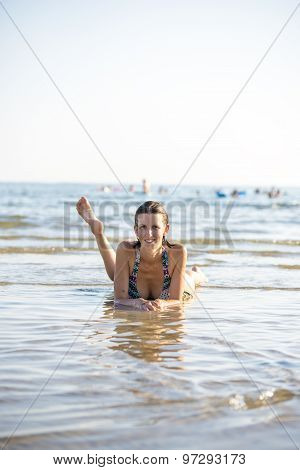 Attractive Young Woman Paddling In The Sea