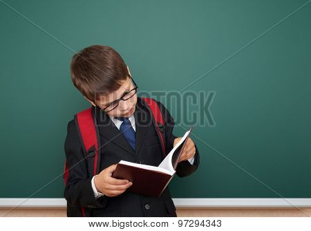 school boy portrait on board background