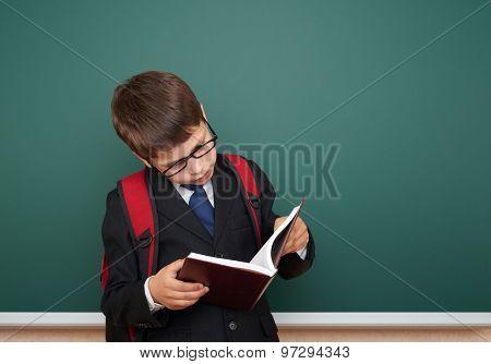 school boy portrait on board background