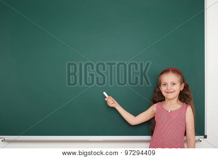 Schoolgirl write on the school board