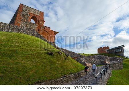 Tourists Climb To Mountain Of Gediminas Along Rocky Road To Gediminas Tower