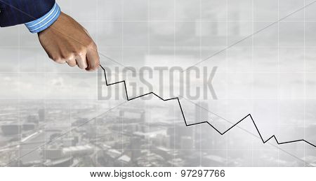 Hand of businessman drawing with pencil increasing graph