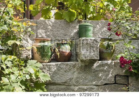 Clay pots on stonewall