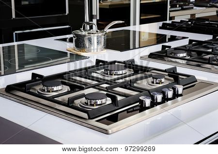Brand new never used gas stove with stainless tray in appliance retail store