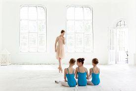 picture of ballerina  - Three little ballerinas with personal ballet teacher in dance studio - JPG