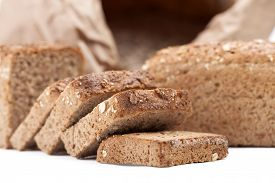 image of fresh slice bread  - Freshly baked sliced bread with sack of wheat in the background - JPG