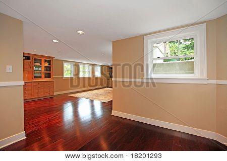 Luxury Basement With Cherry Hardwood And Kitchen