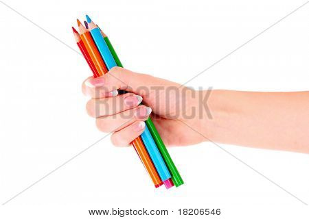 Hand with color pencils isolated on white