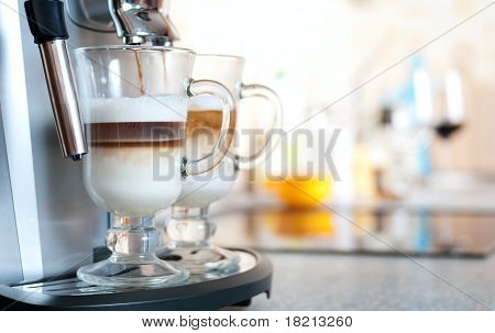 Glasses Fileed With Capuccino In Cofee Machine