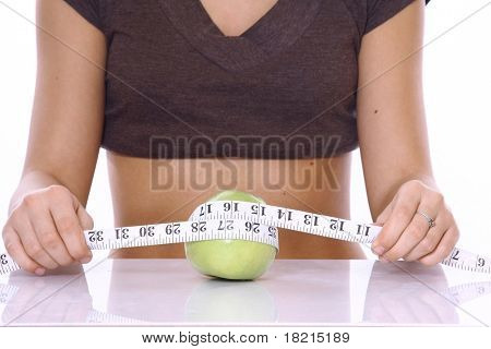 Young beautiful dietician offering apple