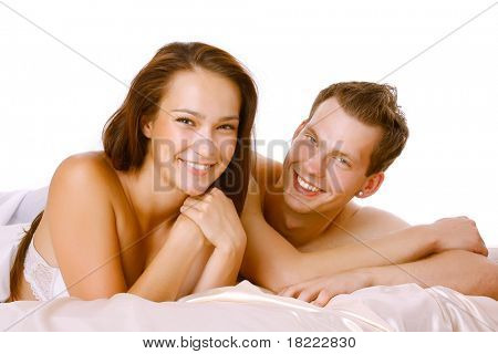 Loving affectionate nude heterosexual couple on bed