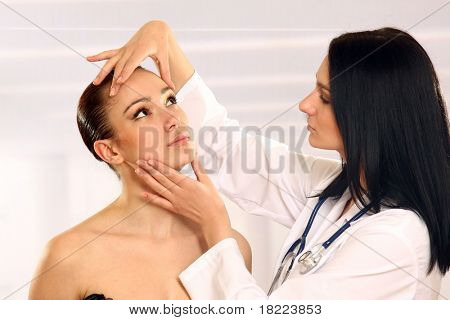 Medical examination face of beautiful woman by beautiful doctor