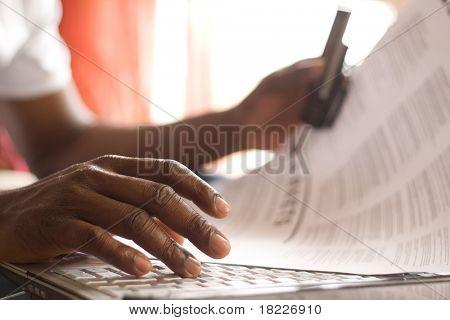 fingers on the laptop keyboard