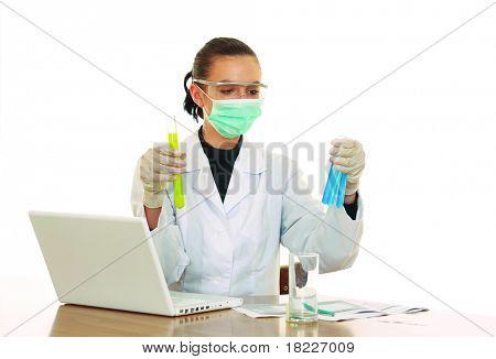 chemist working, focus on test tube