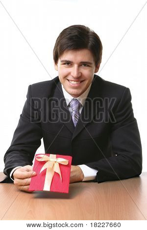 Businessman offering a gift to you