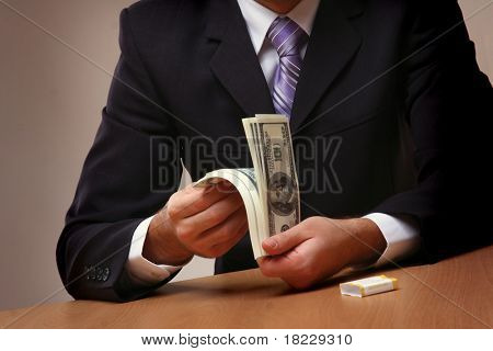 Businessmen passing money with contrac