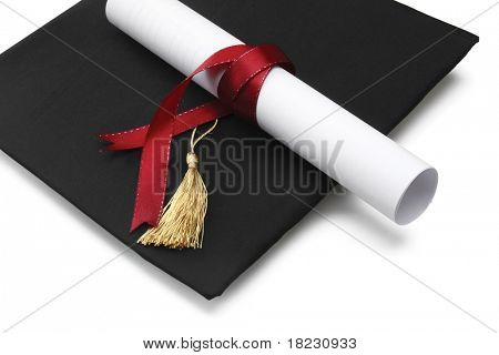book, diploma and graduation cap isolated on white