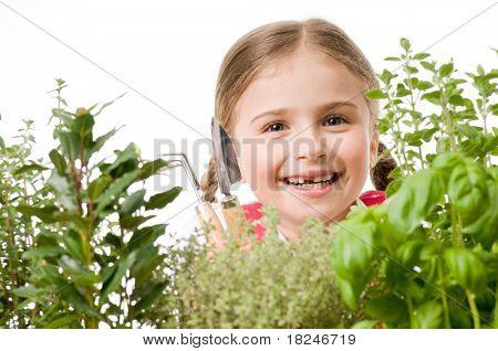 Herbal garden - little girl with garden tools