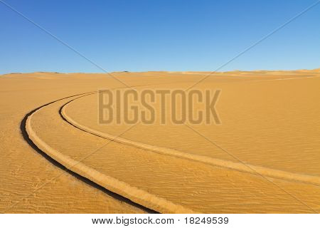 Car Tire Tracks In The Desert
