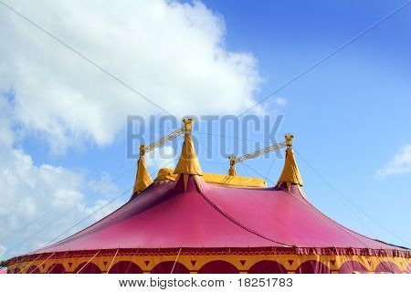 Circus tent red pink color four towers blue sky