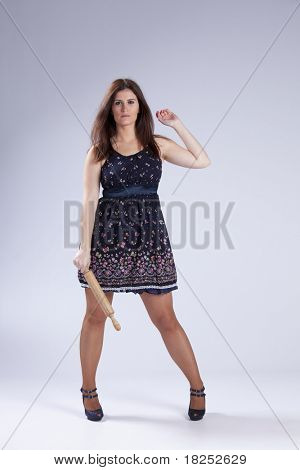 Fashion beautiful woman holding a  wood spoon