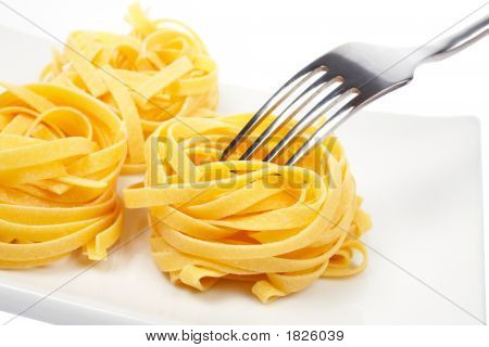 Uncooked Pasta Nests And Fork
