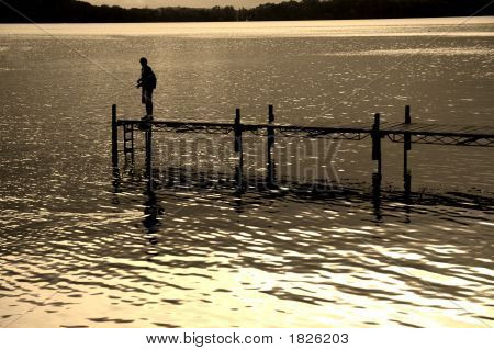 Dock And Fisherman