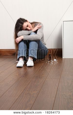 Teenager Distressed And Alone With Bottle Of Pills
