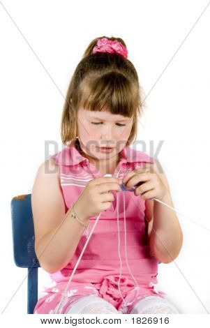 Girl Is Knitting