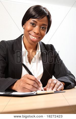 Happy Black Business Woman Signing Document