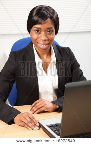 Happy Beautiful Black Woman Using Laptop In Office