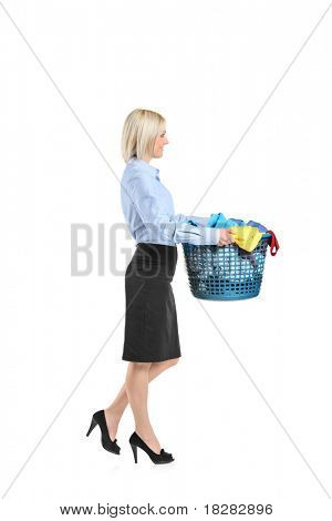 Full length portrait of a young woman carrying a laundry basket isolated on white background
