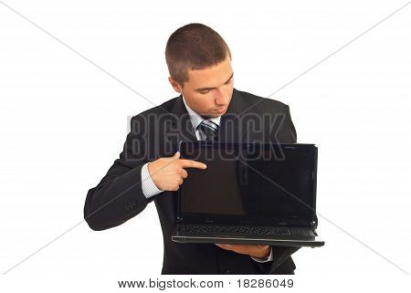 Businessman Pointing And Looking To Laptop Screen