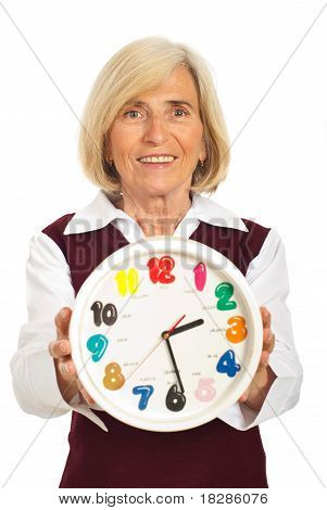 Senior Woman Holding Clock