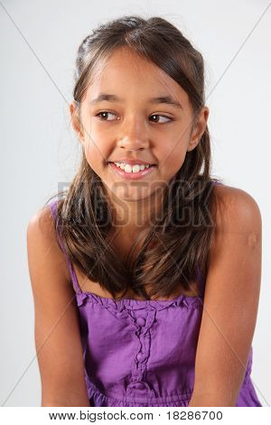 Bashful young schoolgirl wearing purple top