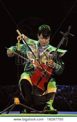 Mongolian ethnic musician performs on stage