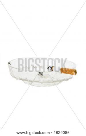 Cigarette In Glass Ashtray