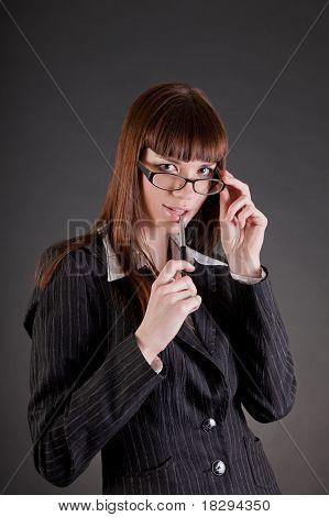 Thoughtful Business Woman Wearing Glasses