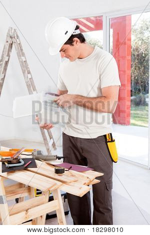 A man looking for a screw, doing home improvements