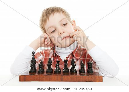 boy thinking under chess