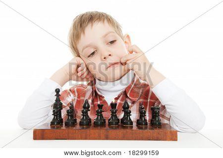 boy thinking under chess