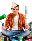 Repair home man holding paint roller for wallpaper. Tired and frustrated male in newspaper cap renov poster